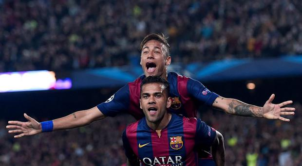 Neymar celebrates with Dani Alves after at the Camp Nou stadium in Barcelona on April 21, 2015.