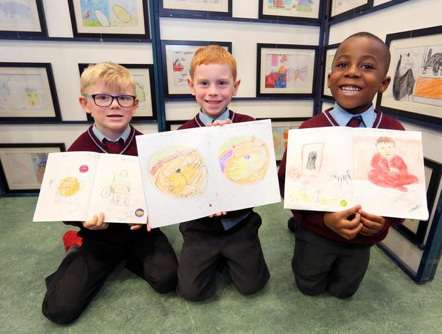 Top of the class: Brody McCann (5), Ryan O'Neill (5), and Adnann Nabinbun Kamara (5), who attend junior infants at St Laurence O'Toole's Junior Boys School at a Zoom Ahead with Books exhibition. Photo: Damien Eagers