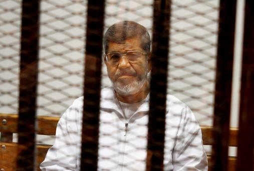 Egypt's ousted Islamist President Mohammed Morsi sits in a defendant cage in the Police Academy courthouse in Cairo, Egypt. Photo: AP
