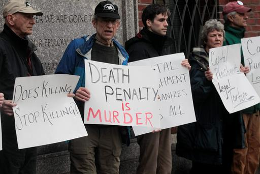 Anti-death penalty protesters stage a vigil outside the court house in Boston where a jury will decide if convicted bomber Dzhokhar Tsarnaev will receive a death sentence or life in prison without parole. Photo: EPA