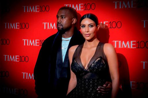 Kanye West and his wife, reality television star Kim Kardashian, arrive for the TIME 100 Gala in New York April 21, 2015. REUTERS/Brendan McDermid
