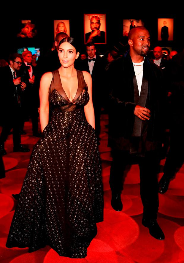 Kim Kardashian, left, and Kanye West attend the 2015 TIME 100 Gala cocktail reception, to celebrate the 100 most influential people in the world