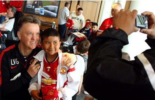 Louis van Gaal with a delighted fan
