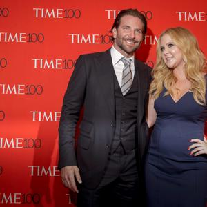 Actor Bradley Cooper (left and comedian Amy Schumer arrive for the TIME 100 Gala in New York. Reuters/Brendan McDermid