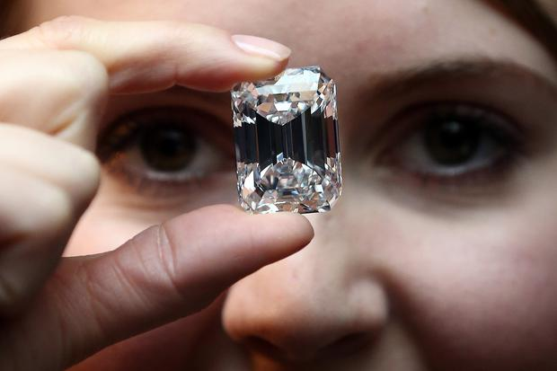 An employee holds a 100-Carat perfect diamond at Sotheby's auction house on February 13, 2015 in London, England. Forming part of the Magnificent Jewels sale in New York