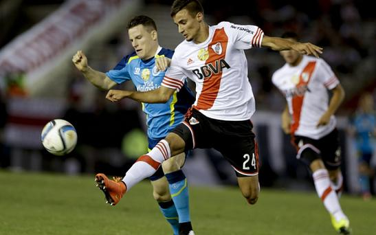 Linked: River Plate's teenager defender Emanuel Mammana is wanted by Arsenal Photo: AP