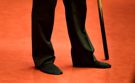 Ronnie O'Sullivan plays in his socks against Craig Steadman, during the Betfred World Championships at the Crucible