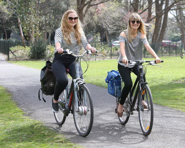 Emma rutter (19) and Charley Cross (19) enjoying a cycle in the phoenix park Credit: Damien Eagers
