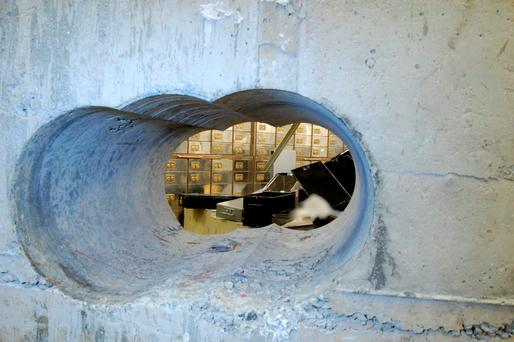 Thieves bored through a half-meter thick concrete wall to access a vault in a safe deposit centre in Hatton Garden, London Credit: British Metropolitan Police \ AFP