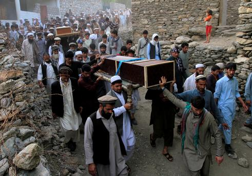 Relatives and residents carry the coffins of victims of a suicide bomb blast in Jalalabad Credit: Parwiz