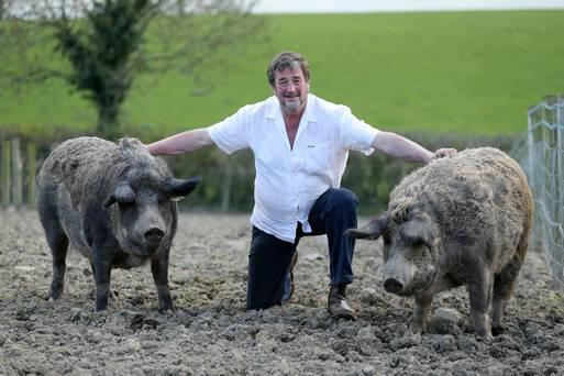Kenny Gracey with two of his pigs Hilda and Mable