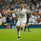 Javier Hernandez celebrates after scoring the winning Champions League goal against Atletico Madrid