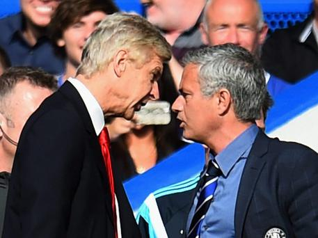Arsenal Wenger confronts Jose Mourinho on the sidelines at Stamford Bridge earlier this season
