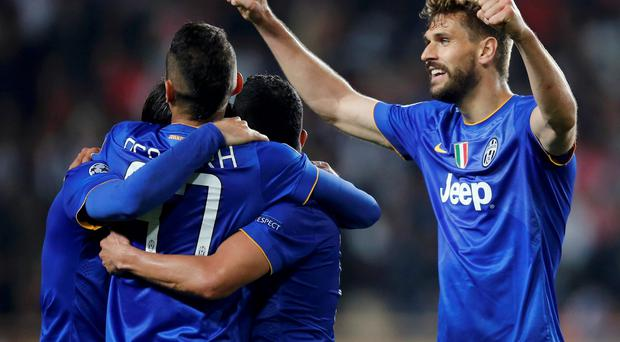 Juventus players celebrate qualifying for the semi-final of the Champions League at Monaco's expense last night