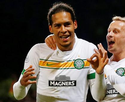Celtic's Virgil van Dijk celebrates with Leigh Griffiths after scoring his side's winning goal against Dundee last night