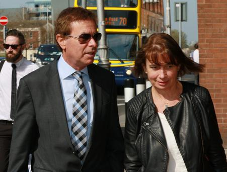 Alan Shatter arrives at the Four Courts yesterday