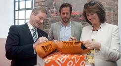 An Taoiseach Enda Kenny TD Robert Gentz, CEO Tanaiste Joan Burton TD during an officiall opening a new operation by Zalando in Ireland a their offices on Barrow Street (Gareth Chaney Collins)