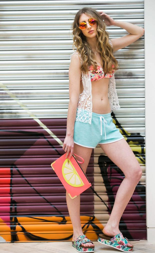 Devon wears Kimono (eur21), bikini (eur7), shorts (eur5), shoes (eur9). Product is available in stores from April. Photograph: Leon Farrell / Photocall Ireland