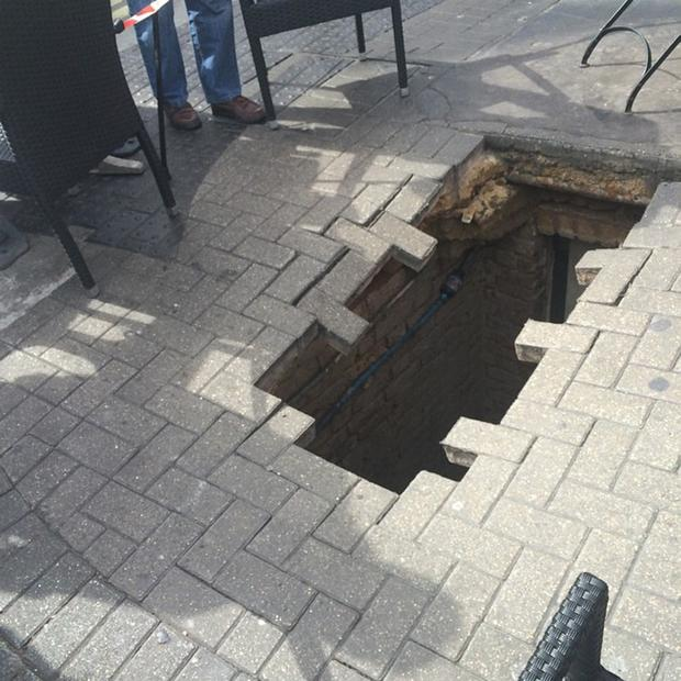 Woman reported to have disappeared down the hole Credit: ktkittenkat