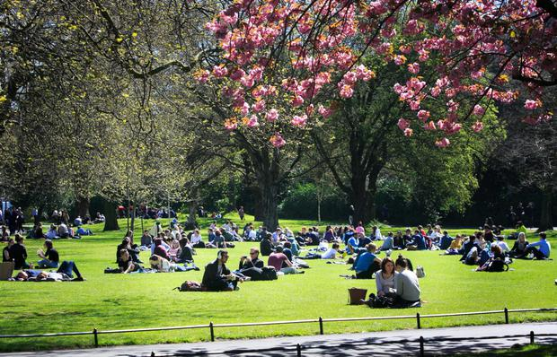 People enjoy the good weather in St. Stephens Green, Dublin. Photo: Gareth Chaney Collins