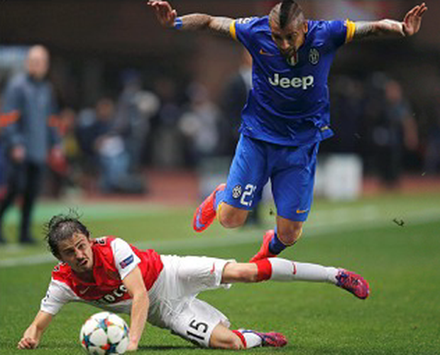 Monaco's Bernardo Silva (left) tackles Juventu's Arturo Vidal during their Champions League quarter-final second leg.