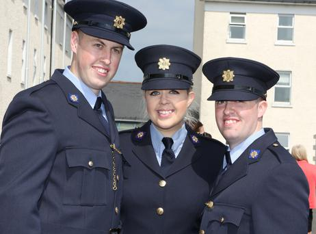 Jennifer Bell with her brothers Joseph and Brian from Lucan, Dublin, at the Garda graduations in Templemore yesterday. Photo: Liam Burke/Press 22