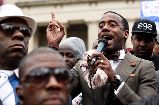 Jeff Johnson delivers a speech in front of City Hall during a protest against the death of Freddie Gray in police custody, in Baltimore April 23, 2015. The U.S. Southern Christian Leadership Conference will independently investigate the death of Gray in police custody, with the local head of the civil rights group saying it lacked confidence in a police probe into the death. REUTERS/Sait Serkan Gurbuz