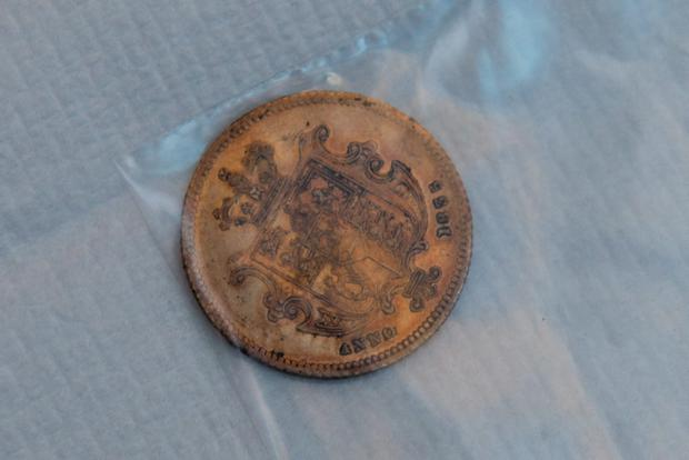 Inpresspics handout photo of a coin discovered under the wax seal which is one of the objects discovered in the cylindrical lead time capsule which was buried in 1839 and discovered 175 years later during the regeneration of Brook Park by Derry City and Strabane District Council. Martin McKeown/Inpresspics/PA Wire