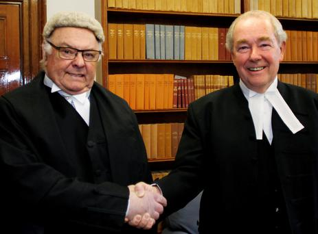 MR. JUSTICE PAUL CARNEY (left) RECEIVES A WARM FAREWELL HANDSHAKE FROM MR JUSTICE NICHOLAS KEARNS, PRESIDENT OF THE HIGH COURT , (right), AT A FAREWELL CEREMONY IN THE FOUR COURTS. (PIC: COURTPIX)