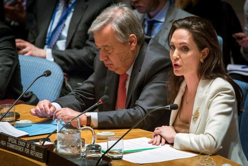 United Nations High Commissioner for Refugees (UNHCR) special envoy, actress Angelina Jolie (R), speaks during a United Nations Security Council meeting regarding the refugee crisis in Syria at the United Nations Headquarters. REUTERS/Lucas Jackson