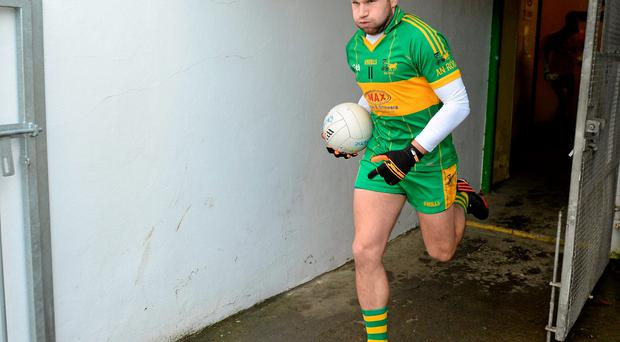 Paraic Sullivan leading out the Rhode team for last year's Leinster club final in Navan