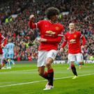 What a difference a year makes as Marouane Fellaini celebrates after scoring against Manchester City
