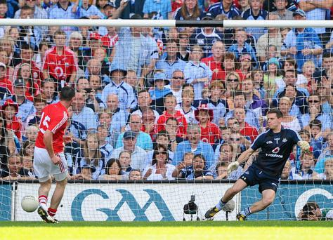 Donncha OConnor, Cork, shoots to score his side's goal, from a penalty, past Dublin goalkeeper Stephen Cluxton