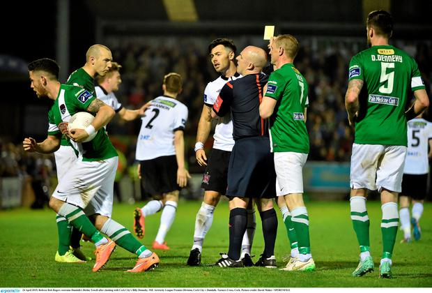 24 April 2015; Referee Rob Rogers restrains Dundalk's Richie Towell after clashing with Cork City's Billy Dennehy. SSE Airtricity League Premier Division, Cork City v Dundalk. Turners Cross, Cork. Picture credit: David Maher / SPORTSFILE
