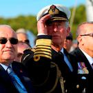 Turkey's President Recep Tayyip Erdogan (R), Prince Charles of Wales (C), and Turkey's Speaker of the Parliament Cemil Cicek (L) looking at the show of Turkish Stars Acrobatic Flight Team during a commemoration ceremony marking the 100th anniversary of the start of the Battle of Gallipoli, at the Turkish Canakkale Martyrs' Memorial. Photo: Getty Images