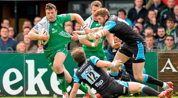 Robbie Henshaw, Connacht, is tackled by Richie Vernon, Glasgow Warriors