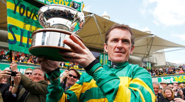 AP McCoy celebrates with the Champions Jockey Trophy