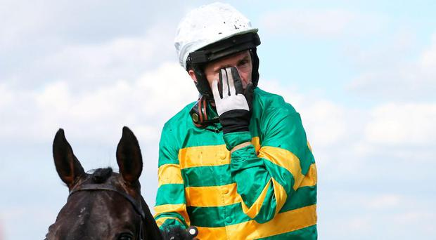 Tony McCoy becomes emotional on Box Office after his last race, the bet365 Handicap Hurdle during the bet365 Jump Finale at Sandown