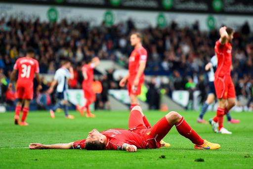 Dejan Lovren of Liverpool lies on the pitch during the Barclays Premier League match between West Bromwich Albion and Liverpool at The Hawthorns
