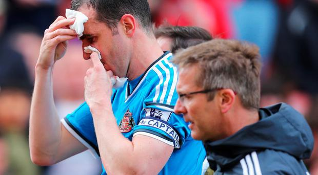 STOKE ON TRENT, ENGLAND - APRIL 25: John O'Shea of Sunderland holds dressings on his face during the Barclays Premier League match between Stoke City and Sunderland at Britannia Stadium on April 25, 2015 in Stoke on Trent, England. (Photo by Dave Thompson/Getty Images)
