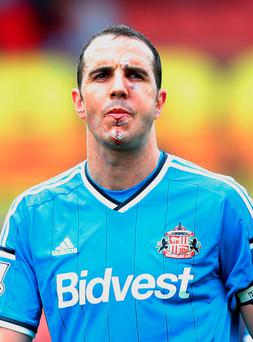 John O'Shea of Sunderland looks on during the Barclays Premier League match between Stoke City and Sunderland at Britannia Stadium