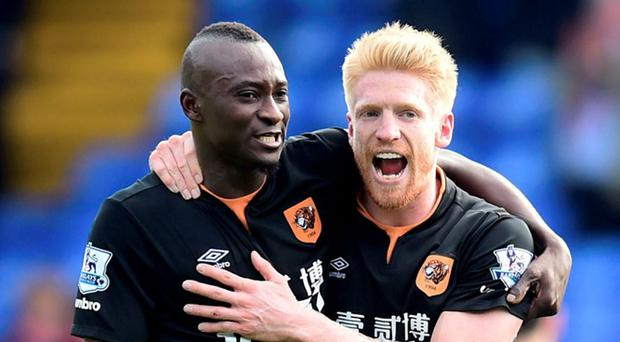 Hull City's Dame N'Doye (left) celebrates with Paul McShane (right) after the game during the Barclays Premier League match at Selhurst Park