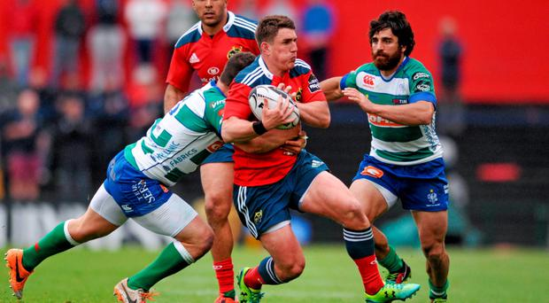 24 April 2015; Ian Keatley, Munster, is tackled by Luca Morisi, Benetton Treviso. Guinness PRO12, Round 20, Munster v Benetton Treviso. Irish Independent Park, Cork. Picture credit: Eoin Noonan / SPORTSFILE