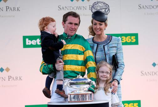 Tony McCoy with his wife Chanelle and children Eve and Archie after being presented with the Chamipon Jockey trophy during the bet365 Jump Finale at Sandown Racecourse