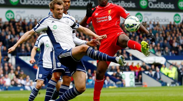 Liverpool's Mario Balotelli in action with West Brom's Gareth McAuley Reuters / Darren Staples Livepic