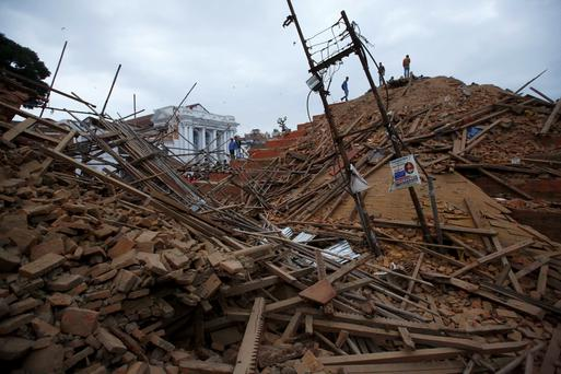 People work to rescue trapped people inside a temple in Bashantapur Durbar Square after an earthquake hit, in Kathmandu, Nepal April 25, 2015. The powerful earthquake struck Nepal and sent tremors through northern India on Saturday, killing hundreds of people, toppling an historic 19th-century tower in the capital Kathmandu and touching off a deadly avalanche on Mount Everest. REUTERS/Navesh Chitrakar