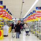 EVERY LITTLE HELPS: Trading profits at Tesco's European operations fell by almost a third to £164m last year