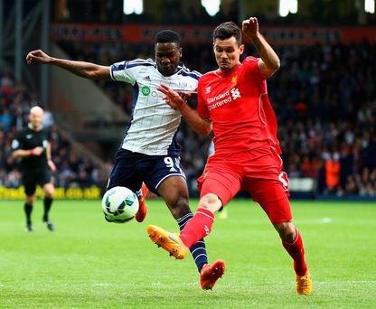 West Brom's Brown Ideye and Dejan Lovren of Liverpool compete for the ball during their match at The Hawthorns yesterday