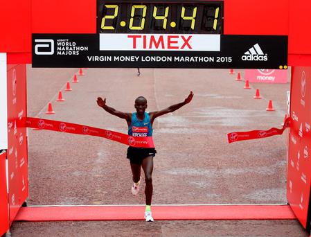 Kenya's Eliud Kipchoge celebrates winning the Men's Elite race during the 2015 Virgin Money London Marathon