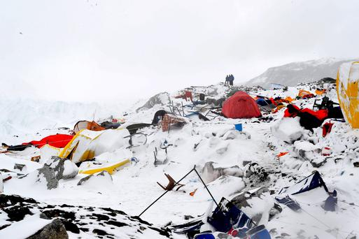 People look on at the devastation after an avalanche triggered by an earthquake flattened parts of Everest Base Camp. AFP PHOTO/Roberto SCHMIDTROBERTO SCHMIDT/AFP/Getty Images